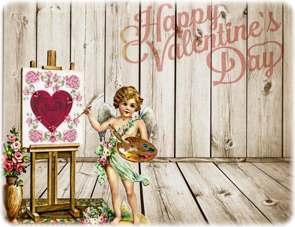 キューピッドが赤いハートと薔薇の絵を描いている