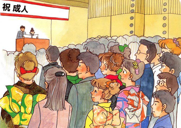 成人式会場で大勢の男女新成人が壇上を見つめている