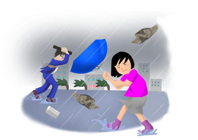 台風の強い風雨に翻弄されて歩く男女