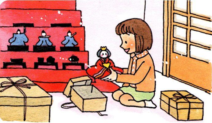 ひな壇にひな人形を飾り付ける女の子